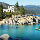 person kayaking in Lake Tahoe with mountains in background