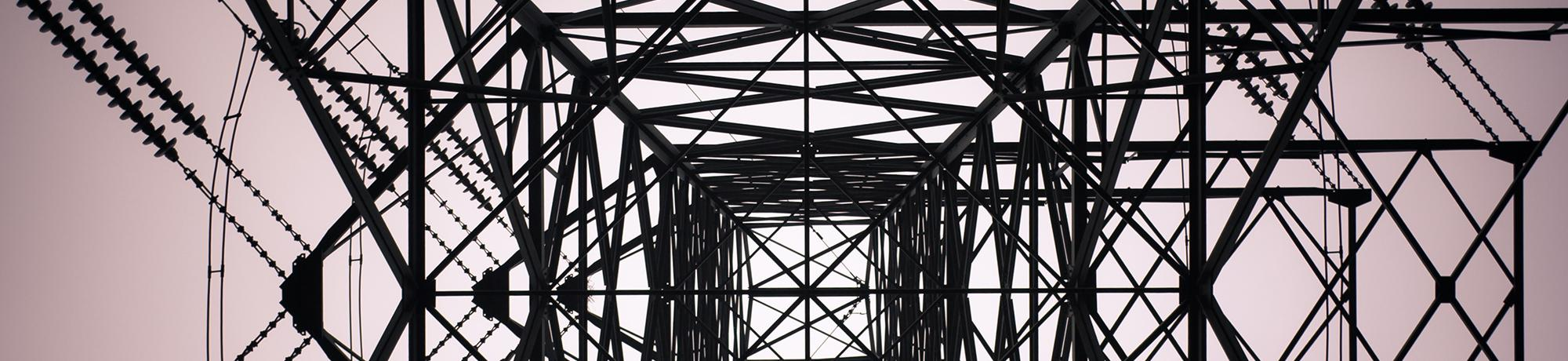 a photograph from underneath a telephone tower