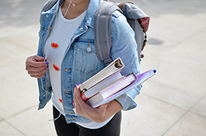 high school student holding her books