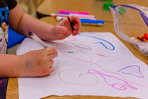 close-up of children's hands making a drawing
