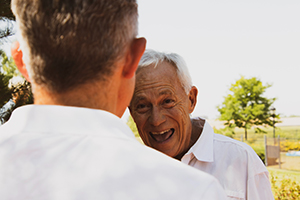 older man smiling along with his friend