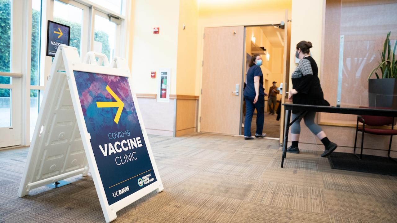 COVID-19 Vaccine Clinic sign at entrance to Davis Campus clinic